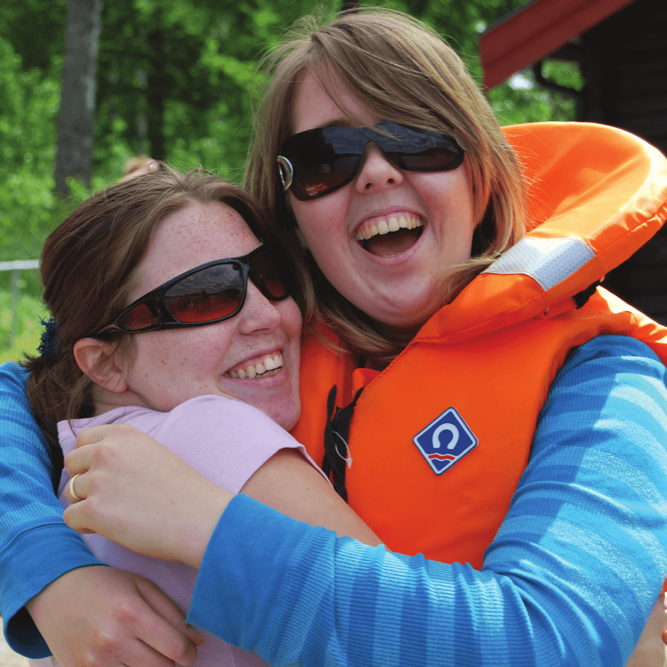 An image of two girls with aniridia smiling on Summer Camp