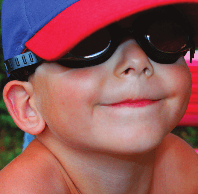 An image of a young boy with aniridia smiling